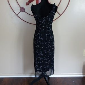 Now anthropologie black floral dress ruffle size M